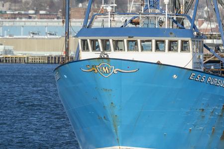 New Bedford, Massachusetts, USA - December 17, 2017: Commercial fishing vessel E.S.S. Pursuit on Acushnet River in New Bedford harbor
