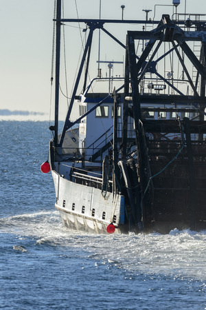 New Bedford, Massachusetts, USA - December 17, 2017: Commercial fishing vessel E.S.S. Pursuit heading into Buzzards Bay from New Bedford Editorial