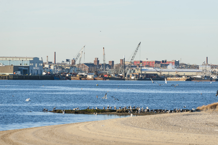 New Bedford, Massachusetts, USA - December 21, 2017: New Bedford waterfront from hurricane barrier looking across Palmers Island