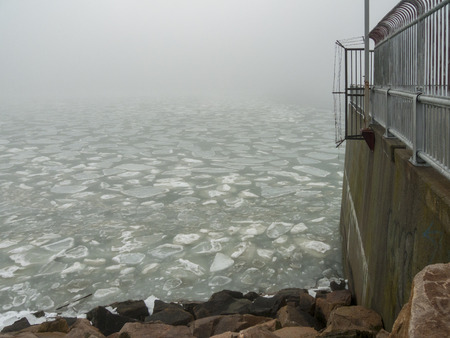 Ice floes driven against hurricane barrier in Fairhaven, Massachusetts by rapidly changing weather conditions Stock Photo