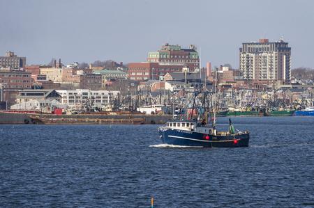 New Bedford, Massachusetts, USA - January 29, 2017: Fishing vessel Tom Slaughter II on Acushnet River with New Bedford in background Redakční