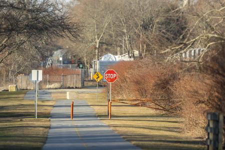 Quiet moment at Egypt Lane on Phoenix Bike Trail in Fairhaven, Massachusetts Фото со стока