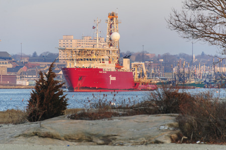 New Bedford, Massachusetts, USA - January 19, 2018: Geotechnical drill ship Fugro Explorer backing toward main channel for dawn departure from New Bedford Редакционное