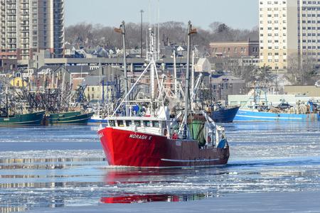 New Bedford, Massachusetts, USA - January 10, 2018: Commercial fishing vessel Moragh K crossing icy New Bedford harbor Redakční