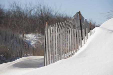 Semi-permeable sand fencing used to minimize erosion of dunes along Massachusetts coast