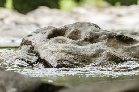 Smooth rock in Blackstone River at Blackstone Gorge