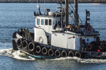 New Bedford, Massachusetts, USA - January 26, 2019: Tug Kodiak leaving New Bedford harbor for Buzzards Bay