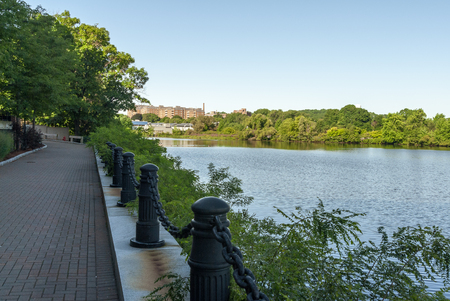 Charles River Greenway in Waltham curving along edge of river Imagens