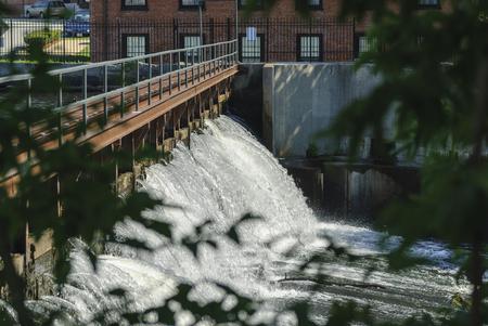 Charles River cascading downstream in Waltham, Massachusetts Banco de Imagens - 118550992