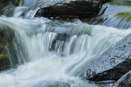 Water cascading along rocky bottom of Blackstone Gorge Imagens