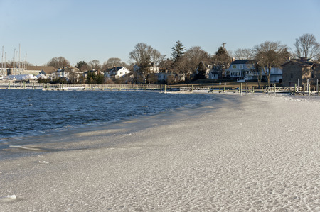 Cold wind pushes developing ice against Fairhaven, Massachusetts shoreline on January morning