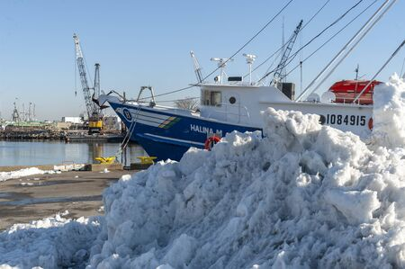 New Bedford, Massachusetts, USA - March 9, 2019: Commercial fishing vessel Halina M almost hidden by snow from recent storm Editorial