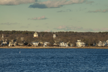 Late winter afternoon view of shoreline in Mattapoisett harbor Imagens