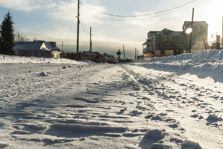 Low angle of plowed beach road in aftermath of snow storm 免版税图像