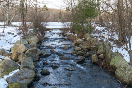 Stream bed for runoff from leach pond in Borderland State Park 写真素材