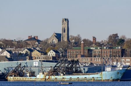 New Bedford, Massachusetts, USA - November 29, 2014: Clammers docked at Eastern Fisheries plant along New Bedford waterfront