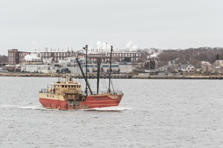 New Bedford, Massachusetts, USA - April 12, 2019: Eastern rig Explorer heading into New Bedford on gloomy morning Editorial