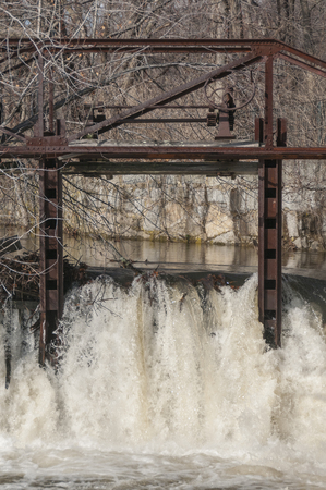 Rusting operational gear on old dam infrastructure still in place on Blackstone River