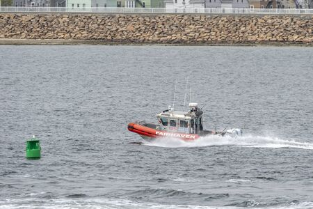 Fairhaven, Massachusetts, USA - May 3, 2019: Fairhaven Fire Department patrol boat hurries down Acushnet River toward Buzzards Bay on choppy morning Redakční