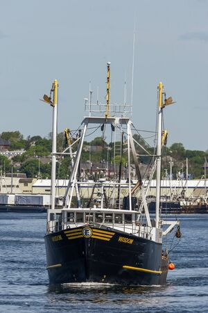 New Bedford, Massachusetts, USA - May 25, 2019: Scalloper Wisdom heading out of New Bedford harbor to go fishing