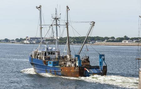 New Bedford, Massachusetts, USA - June 28, 2019: Commercial fishing vessel Blue South transiting New Bedford hurricane barrier 에디토리얼