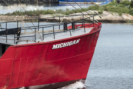 Fairhaven, Massachusetts, USA - May 31, 2019: Bow of eastern rig fishing vessel Michigan as she clears hurricane barrier