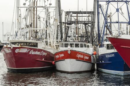 New Bedford, Massachusetts, USA - July 8, 2019: Commercial fishing vessels Gastons Legacy, Captain Lyman and Resilient  docked in New Bedford Editorial