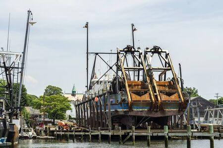 Fairhaven, Massachusetts, USA - July 4, 2019: Commercial fishing vessel E.S.S. Endeavor, hailing port Barnegat Light, New Jersey, hauled out in Fairhaven Sajtókép