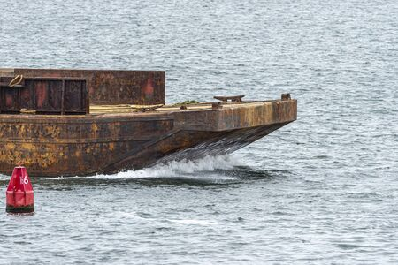 Bow of barge being pushed toward hurricane barrier in New Bedford, Massachusetts Imagens