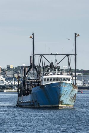 New Bedford, Massachusetts, USA - June 15, 2019: Clammer E.S.S. Pride heading out to fish