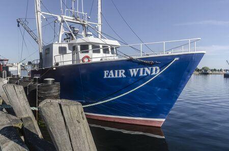 Fairhaven, Massachusetts, USA - June 9, 2019: Scalloper Fair Wind docked at Union Wharf on morning in late Spring