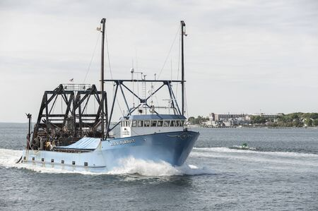 New Bedford, Massachusetts, USA - June 3, 2019: Commercial fishing vessel E.S.S. Pursuit returning from trip