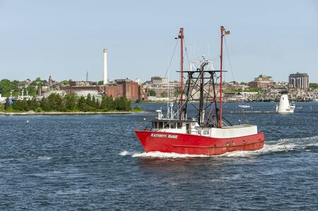 New Bedford, Massachusetts, USA - June 3, 2019: Commercial fishing vessel Kathryn Marie leaving New Bedford waterfront