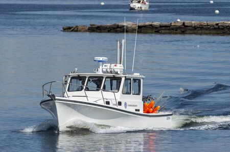 New Bedford, Massachusetts, USA - May 16, 2019: Fisheries Research vessel operated by Commonwealth of Massachusetts leaving New Bedford Redakční