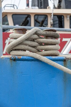Intricately wrapped line secures commercial fishing vessel to wharf