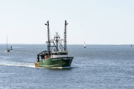 New Bedford, Massachusetts, USA - August 12, 2019: Trawler Lightning Bay returning from fishing trip Editorial