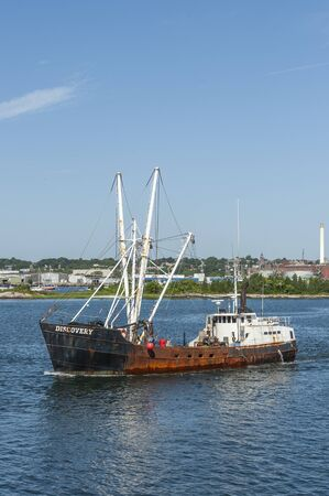 New Bedford, Massachusetts, USA - August 20, 2019: Eastern rig commercial fishing vessel Discovery leaving New Bedford