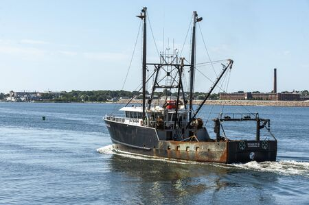 New Bedford, Massachusetts, USA - August 20, 2019: Commercial fishing vessel Sharon K leaving New Bedford