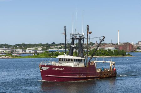 New Bedford, Massachusetts, USA - August 20, 2019: Commercial fishing vessel Vantage passing Palmer Island in New Bedford harbor Editorial