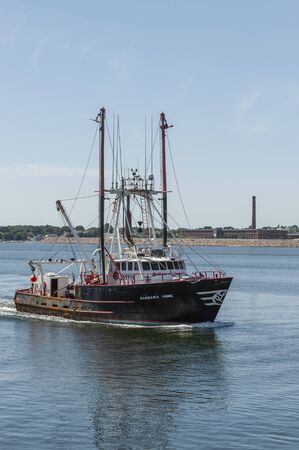 New Bedford, Massachusetts, USA - August 20, 2019: Commercial fishing vessel Barbara Anne, hailing port Cape May, New Jersey, approaching New Bedford Editorial