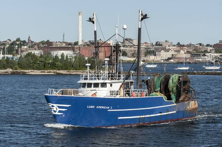 New Bedford, Massachusetts, USA - August 24, 2019: Commercial fishing vessel Luso American I heading out on trip Editorial