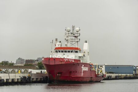 New Bedford, Massachusetts, USA - August 22, 2019: Geophysical survey vessel Fugro Searcher docking at Marine Commerce Terminal on overcast morning Editorial