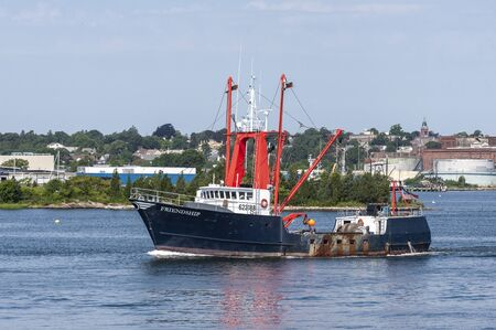 New Bedford, Massachusetts, USA - August 19, 2019: Scalloper Friendship passing New Bedford waterfront on way to sea Editorial