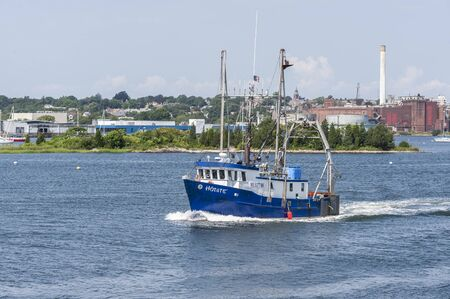 New Bedford, Massachusetts, USA - August 19, 2019: Scalloper dragger Hotate passing Palmer Island on way to sea Editorial