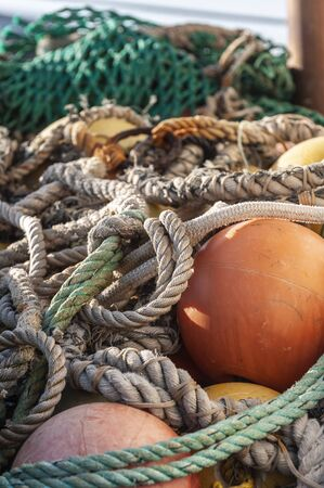 Pile of lines, nets and buoys on deck of commercial fishing boat Stok Fotoğraf