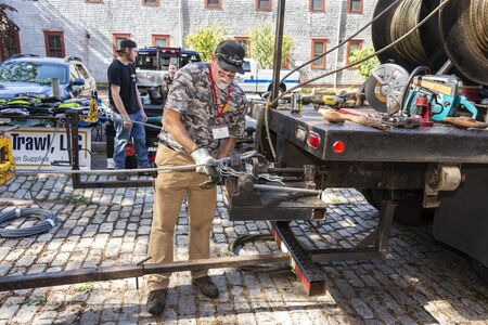 New Bedford, Massachusetts, USA – September 28, 2019: Mike Smith of North Eastern Trawl in New Bedford performing a wire splicing demonstration at the Big Boats Little Boats Festival in front of the New Bedford Fishing Heritage Center 新聞圖片