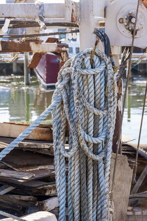 Cluttered deck on out of service fishing boat Stok Fotoğraf