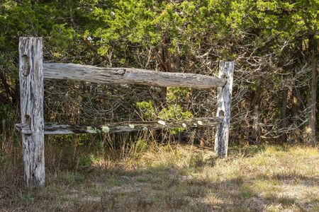 Isolated section of split rail fence along trail at Fort Hill on Cape Cod Фото со стока