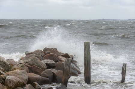 Noreaster pushing up waves along Fairhaven coastline in New Bedford outer harbor