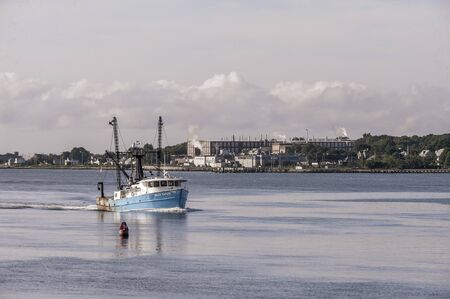 New Bedford, Massachusetts, USA - August 27, 2019: Commercial fishing boat Miss Taylor, hailing port Atlantic City, New Jersey, crossing New Bedford outer harbor